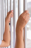 Hands of a man try to get out from jail Royalty Free Stock Photos