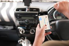 Hands of man using mobile smart phone with gps application in th. E car for mobile technology concept stock photography
