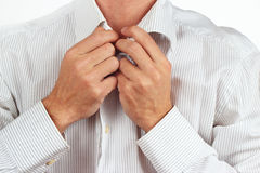 Hands a man wear light colored shirt closeup. Hands a man wear light colored shirt close up Stock Image