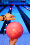 Hands of man, which holds ball in bowling club royalty free stock photography