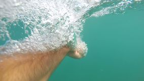 Hands of the man who is swimming. Underwater shot stock video
