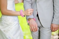 Hands of man and woman bride groom in handcuffs Royalty Free Stock Photos
