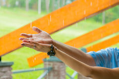 Hands of a man and a woman. Hands of a man and a woman catching rain drops Stock Photography
