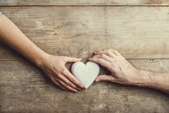 Hands of man and woman connected through a heart. Stock Photos