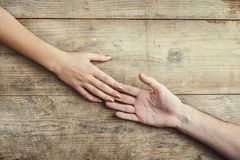 Hands of man and woman holding together. stock images