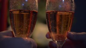 Hands man and a woman who clink glasses with champagne. Valentines day. making a marriage proposal. stock video