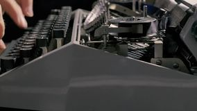 The hands of a man writing on an old typewriter. stock video
