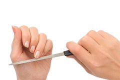 Hands and manicure nail file Royalty Free Stock Image