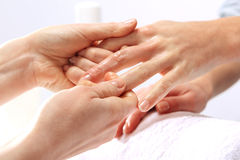 Hands manicurist and client care while performing surgery Royalty Free Stock Image