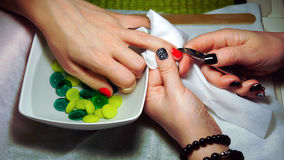 Hands manicurist and client closeup Stock Photos