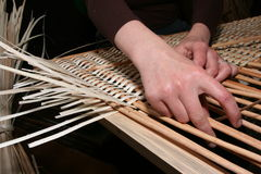 Hands manually mastering wicker fabric 6 Stock Image