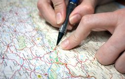 Hands on a map. Close up of hands on a map Royalty Free Stock Photography