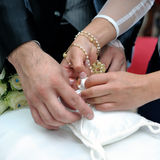 Hands in marriage Stock Photos