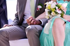 Hands of married mixed couple with big love stock photos