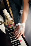 Hands of married man and woman with wedding rings are laying on keys of piano Royalty Free Stock Image
