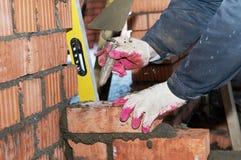 Hands of a mason at bricklaying Stock Photography