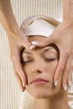 Hands massage on face Stock Photos