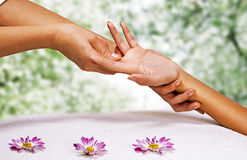 Hands massage in the spa salon. In the garden Royalty Free Stock Photography