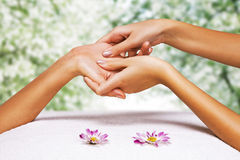 Hands massage in the spa salon. In the garden Stock Photo
