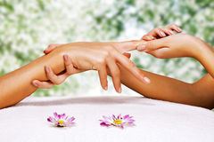 Hands massage in the spa salon. In the garden Stock Photos