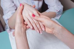 Hands massage in the spa salon Royalty Free Stock Images