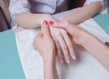 Hands massage in the spa salon Stock Photo