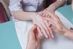 Hands massage in the spa salon Stock Photography