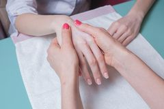 Hands massage in the spa salon Stock Photos