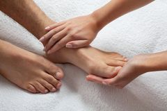 Hands Massaging Feet Royalty Free Stock Photo