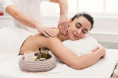 Male masseur doing professional body massage Stock Images