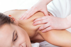 Hands massaging female neck Royalty Free Stock Image