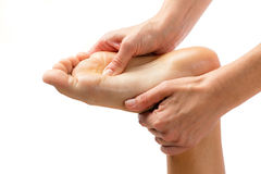 Hands massaging foot isolated. Stock Image