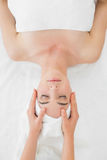 Hands massaging woman's face at beauty spa Royalty Free Stock Photo