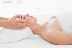 Hands massaging woman's face at beauty spa Royalty Free Stock Photography