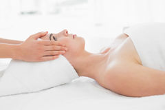 Hands massaging woman's face at beauty spa Royalty Free Stock Images