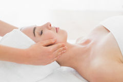 Hands massaging woman's face at beauty spa Stock Images