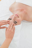 Hands massaging woman's forehead at beauty spa Royalty Free Stock Image