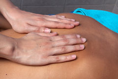 Hands of masseur Royalty Free Stock Photography