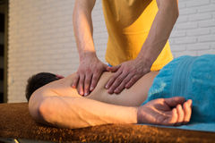Hands of a masseuse Royalty Free Stock Image