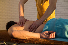 Hands of a masseuse Stock Photography