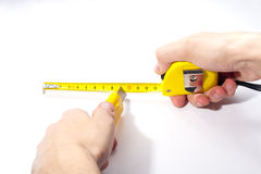Hands with measuring tape and cutting tool Royalty Free Stock Photos