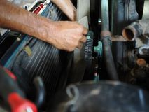 Hands of mechanic checking cooling fan of car in garage. Auto repair service. Stock Photos