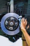Hands of a mechanic install brake lining Stock Photo