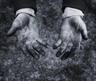 Hands of a mechanic in oil and fuel oil, black and white Royalty Free Stock Photos