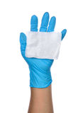 Hands of a medic wearing a blue latex gloves Royalty Free Stock Images