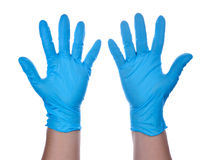 Hands of a medic wearing a blue latex gloves Stock Image