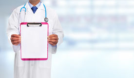 Hands of medical doctor with clipboard. Royalty Free Stock Image