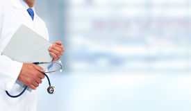 Hands of medical doctor with clipboard. Royalty Free Stock Photos