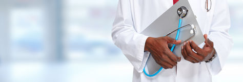 Hands of medical doctor with clipboard. Royalty Free Stock Photography
