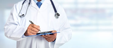 Hands of medical doctor with clipboard. Health care background